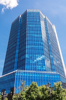 The highrise office building is located in the business center of the city urban landscape