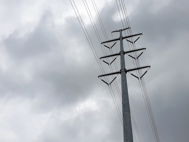 Highvoltage electrical transmission line on nimbus clouds in the sky backgrounds