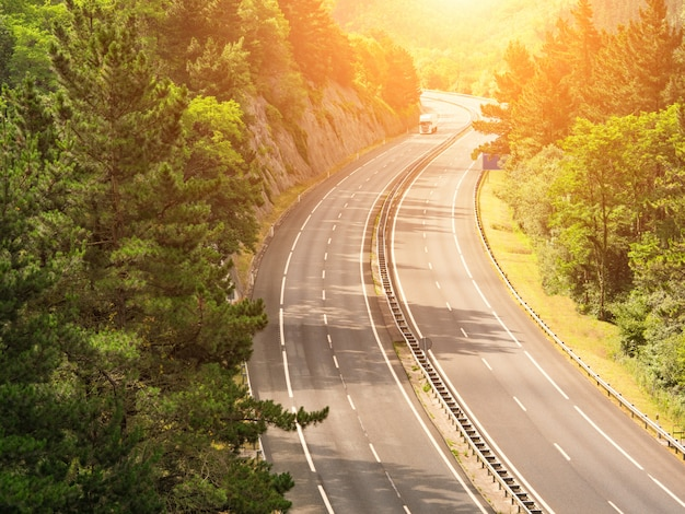 Highway across forested landscape