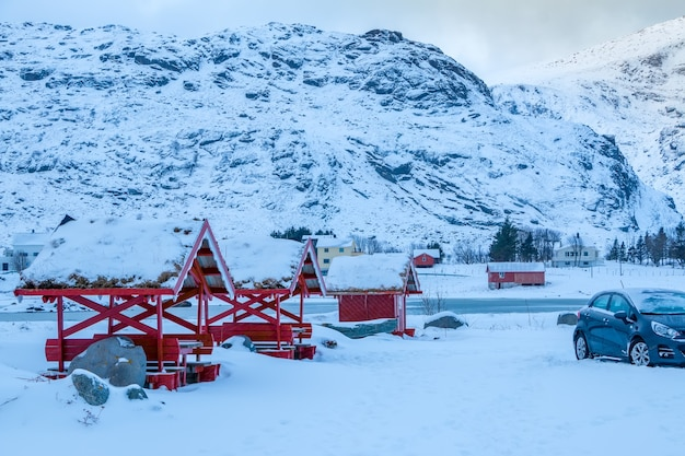 Highway among the mountains in winter norway. a lot of snow. pergolas with traditional grass roofs