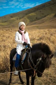 Hijab woman ride a horse at bromo  east java