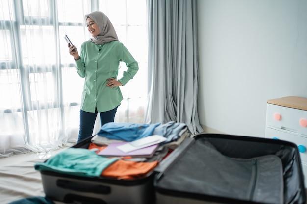Hijab woman using smartphone