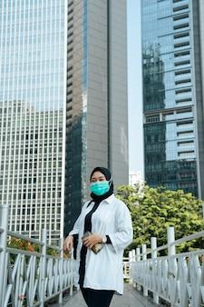 Hijab women wearing masks in urban areas