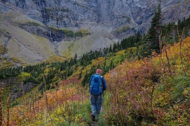 Hike in the autumn mountains. fall season theme.