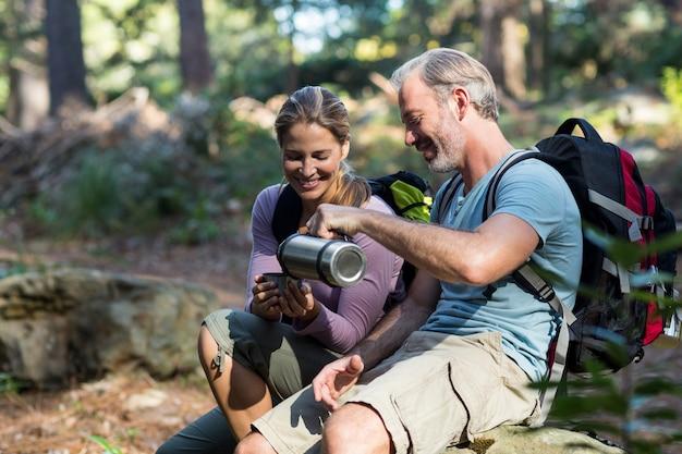 Hiker couple having coffee
