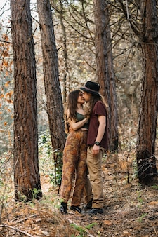 Hiker couple in love kissing in nature