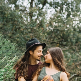Hiker couple in love sitting in nature