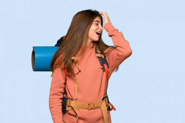 Hiker girl has just realized something and has intending the solution on blue background