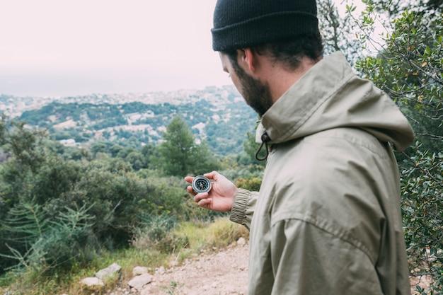 Hiker looking at compass