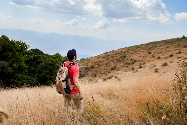 Hiker looking at fields