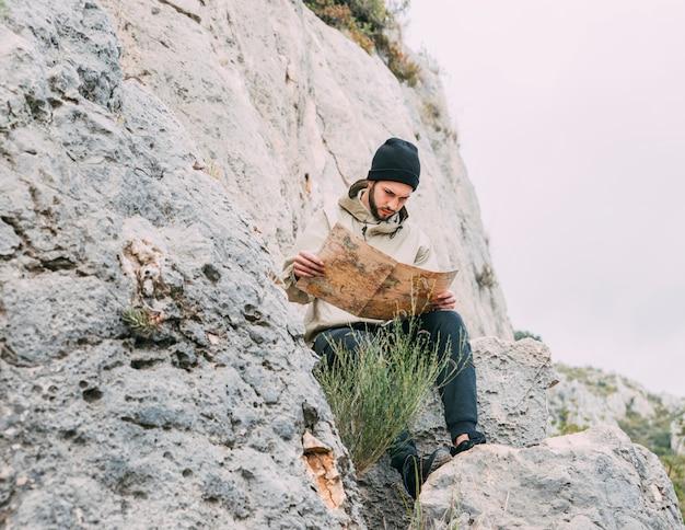 Hiker looking at map