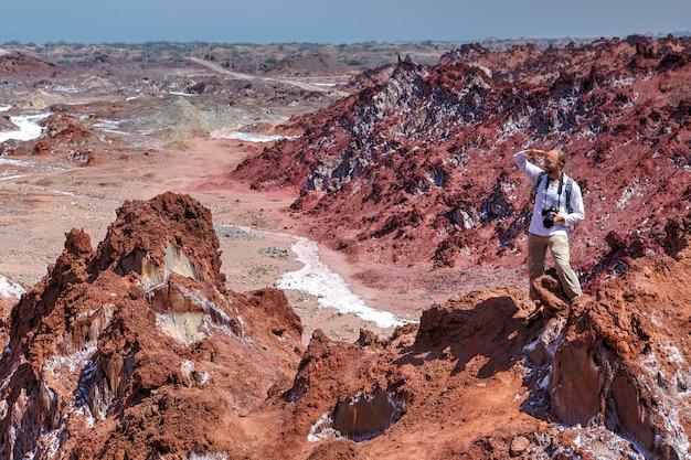 Hiker makes hike in salt mountains hormuz island, hormozgan, iran.