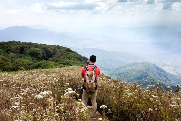 Hiker in mountainous landscape