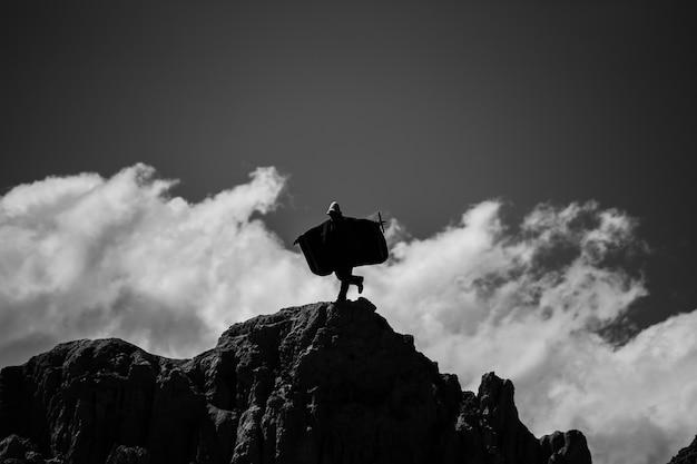 Hiker on the peak mountains of valle de la luna in la paz