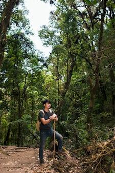 Hiker resting in jungle