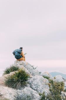 Hiker sitting on rocks