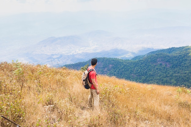 Hiker standing in the mountains