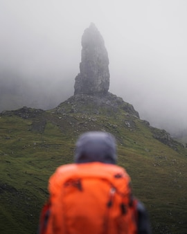 Hiker at the storr on isle of skye, scotland