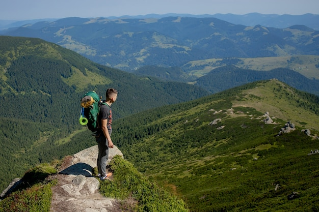 Hiker on the top in carpathians mountains. travel sport lifestyle concept