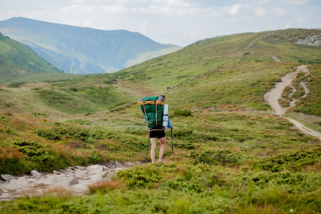 Hiker on the top of mountains climbing