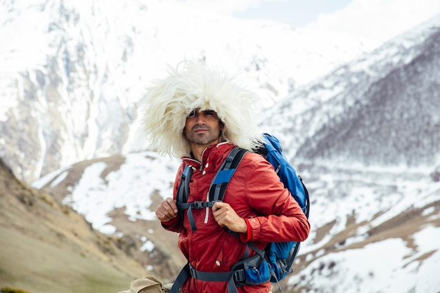 Hiker with traditional papakha fur hat at mtskheta, mtianeti region in georgia