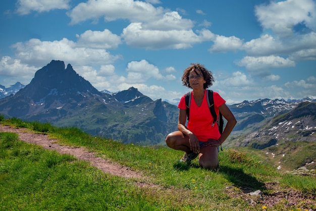 Hiker woman with pic du midi ossau in the french pyrenees