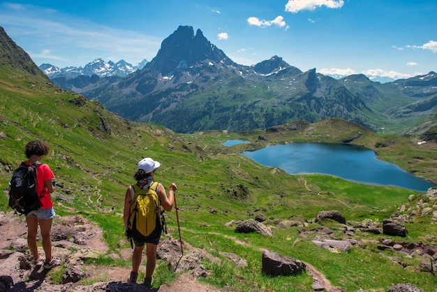 Hiker women in path of pic du midi ossau in the french pyrenees mountains