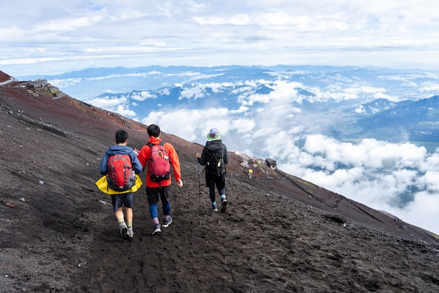 Hikers climbing on yoshida trail on fuji mountain in climbing season