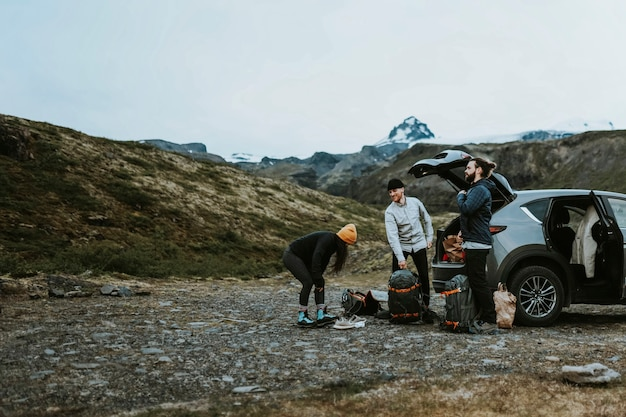 Hikers getting stuff from the car boot