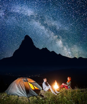 Hikers under starry sky