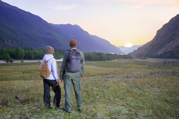 Hikers with backpacks relaxing.