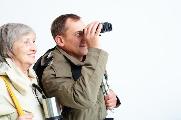 Hikers with binocular enjoying view
