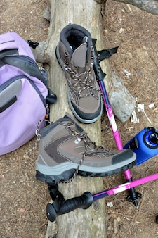 Hiking boots and backpack positions in nature