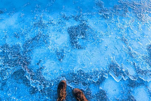 Hiking boots on frozen ground