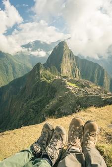 Hiking boots at machu picchu, peru, toned image