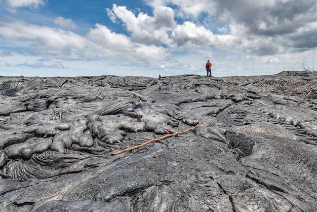 Hiking on extremely hot lava bed. adventure activity in hawaii volcanoes national park
