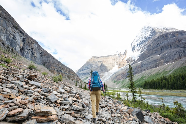 Hiking man in canadian mountains. hike is the popular recreation activity in north america.