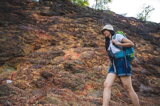 Hiking or running woman in landscape mountains. sole of sports shoe and legs on rock trail. hiker trekking or walking of footpath, outdoors lifestyle