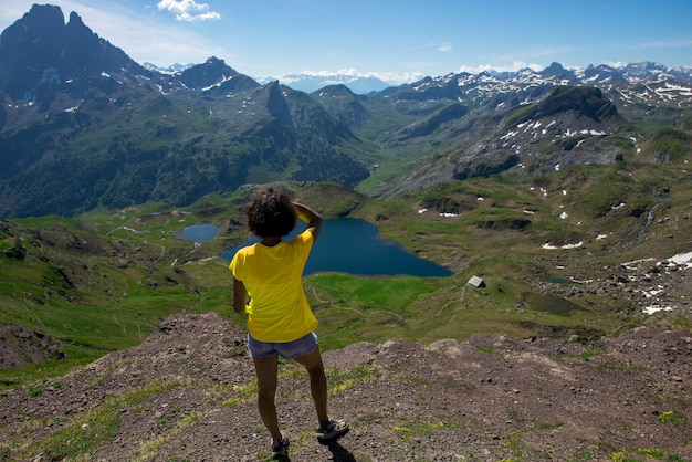 Hiking woman looking pic du midi ossau in the french pyrenees mountains