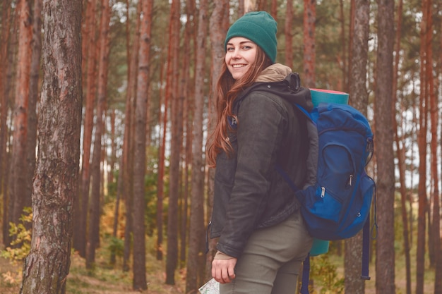 Hiking woman portrait smiling happy in forest