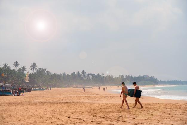 Hikkauwa, sri lanka. people on the beach.