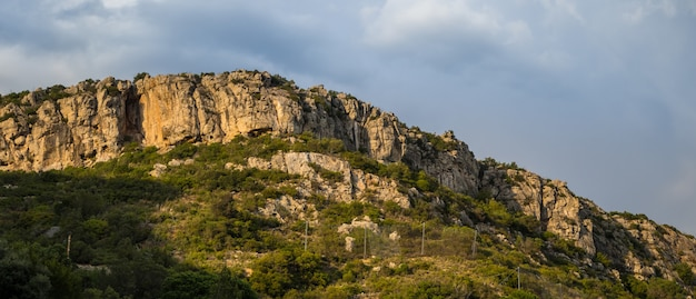 Hill covered in greenery and rocks in the arrabida natural park in setubal, portugal