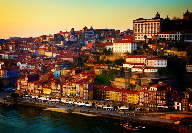 Hill with old town of porto at sunset, portugal, retro toned