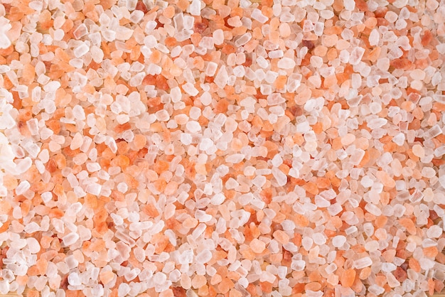 Himalayan pink salt crystals background, scrub spa therapy