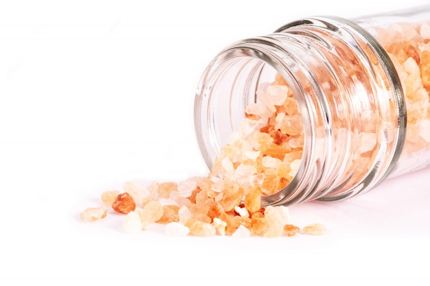 Himalayan pink salt isolated on white . health concept.