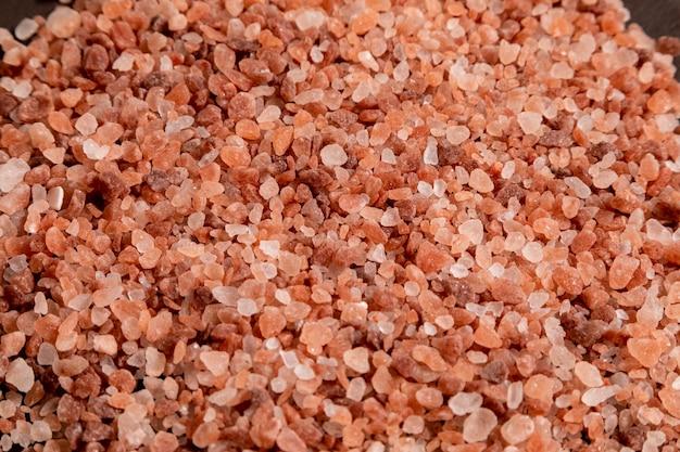 Himalayan pink salt on top of a rock. selective focus.