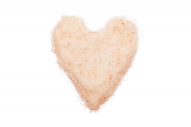 Himalayan salt, heart-shaped, isolated, close up, macro, top view.