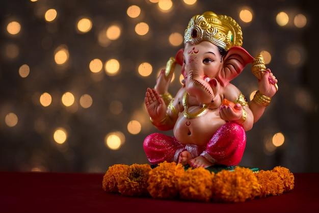 Hindu god ganesha on blured bokhe, ganesha idol.