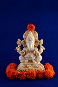 Hindu god ganesha. ganesha idol on blue background