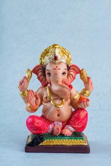 Hindu god ganesha. ganesha idol on blue space.